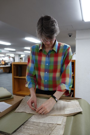 Photo of Professor Emily Kadens researching sixteenth-century cases in manuscript at the National Archives, Kew, London