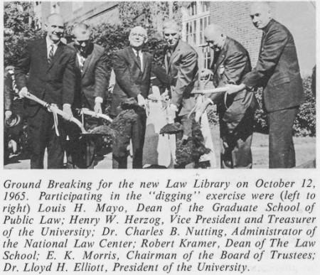 "The ""digging""team at work: GW luminaries join together to break ground for the new Law Library (1965)."